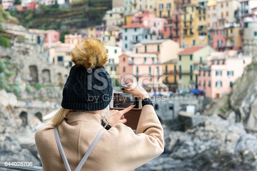 istock Manarola - woman capturing photo on phone 644025706