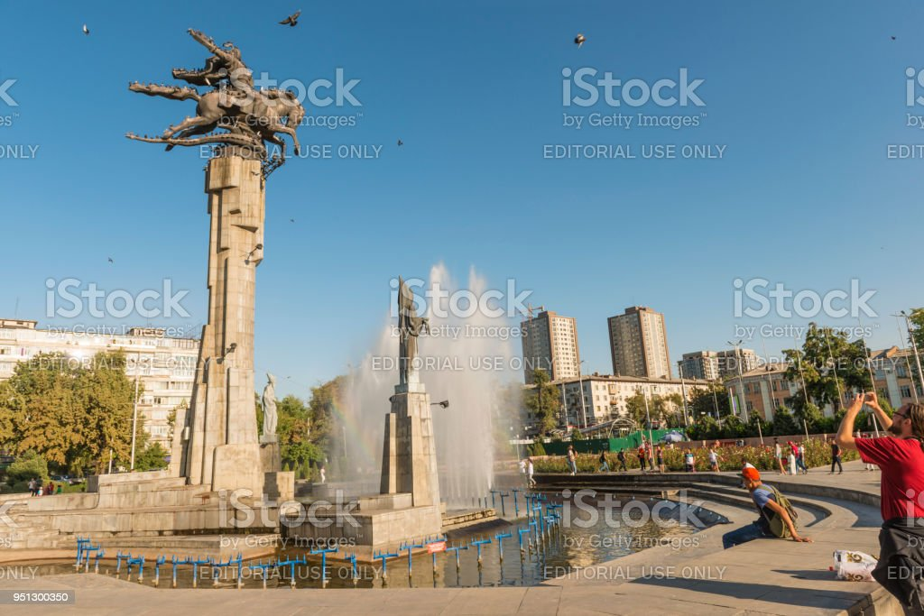 Manas Statue in fountain with urban background stock photo