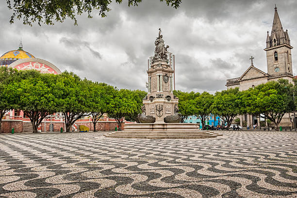 Manaus Brazil Praca Sao Sebastiao Photo of Praca Sao Sebastiao (St. Sebastian Square) with the Amazon Theatre and the Sao Sebastiao church in downtown Manaus, a city in the heart of the Amazon rainforest, in the state of Amazonas, Brazil. manaus stock pictures, royalty-free photos & images