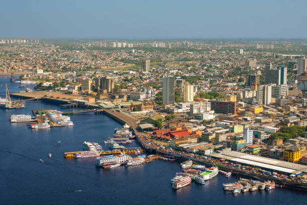 Manaus, capital of the State of Amazonas Downtown Manaus. The city at the border of Rio Negro. River Negro The typical ships from the Amazon region. They transport passengers and cargo manaus stock pictures, royalty-free photos & images