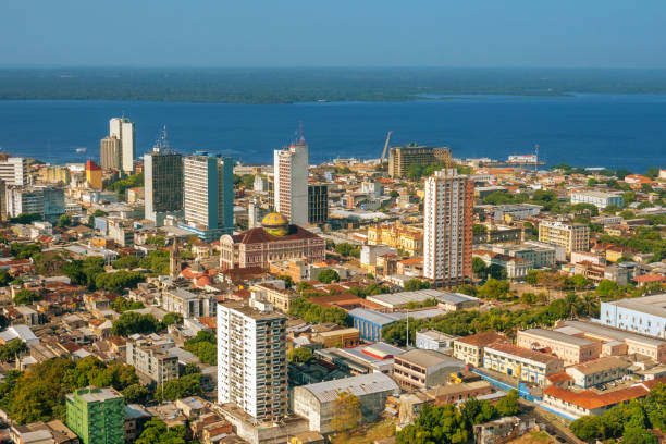 Manaus, capital of the state of Amazonas Main urban, financial and industrial center of the Amazon region Located at the border of Negro River Amazonas Theater in the middle of the photo manaus stock pictures, royalty-free photos & images