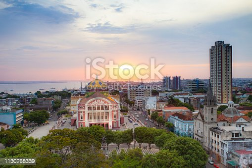 August 27, 2013 - Manaus, Brazil: Sunset over the city of Manaus, showing the front view the Opera house of Manaus, the buildings, streets and the Rio Negro river in the background.