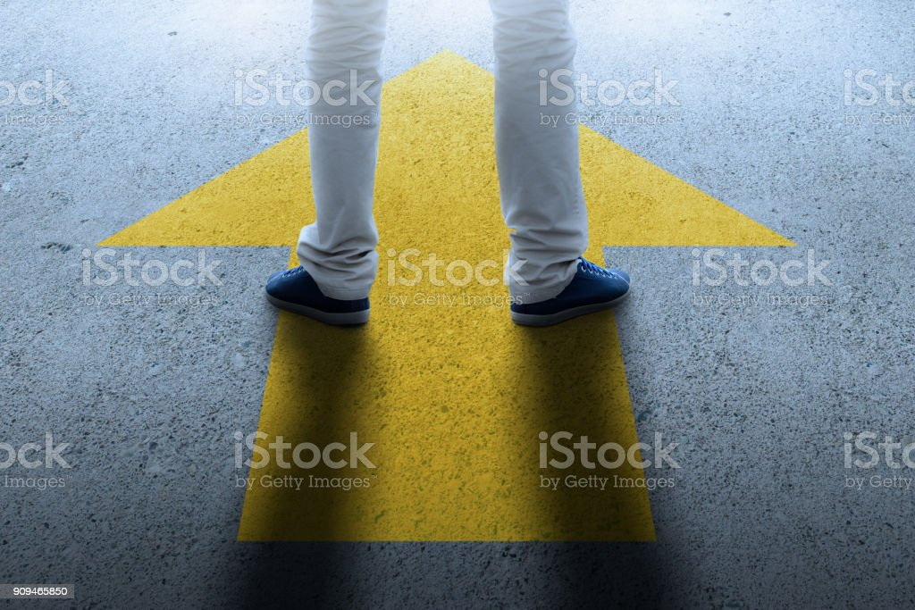 W3 Man/boy thinking about future, arrow pointing forward - foto stock