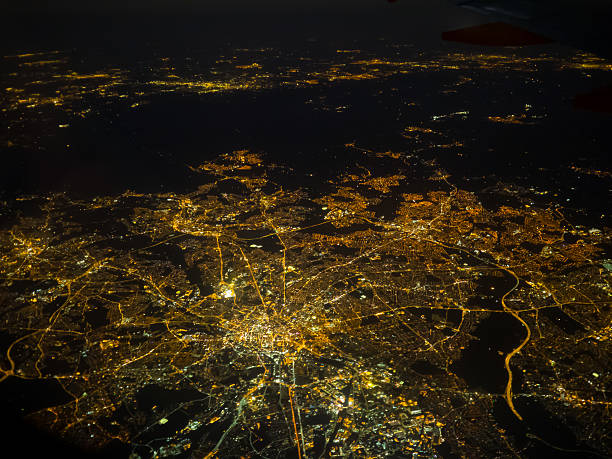 manchester at night - urban sprawl stock photos and pictures