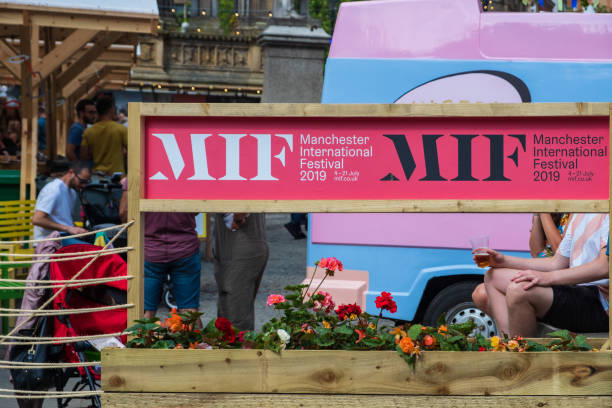 Manchester International Festival 2019 poster and food stalls in the background at the Manchester Town Hall stock photo