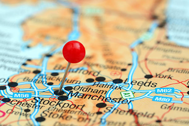 Manchester pinned on a map of europe Photo of pinned Manchester on a map of europe. May be used as illustration for traveling theme. northwest england stock pictures, royalty-free photos & images