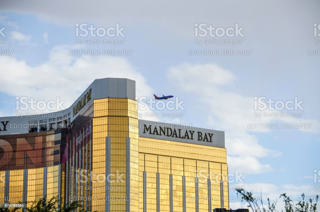 Mandalay Bay building exterior on strip with airplane stock photo