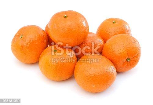 Mandarin isolated on white background, pyramid of mandarins on white background, stack of mandarins. Conceptual photo. Exotic tropical fruit