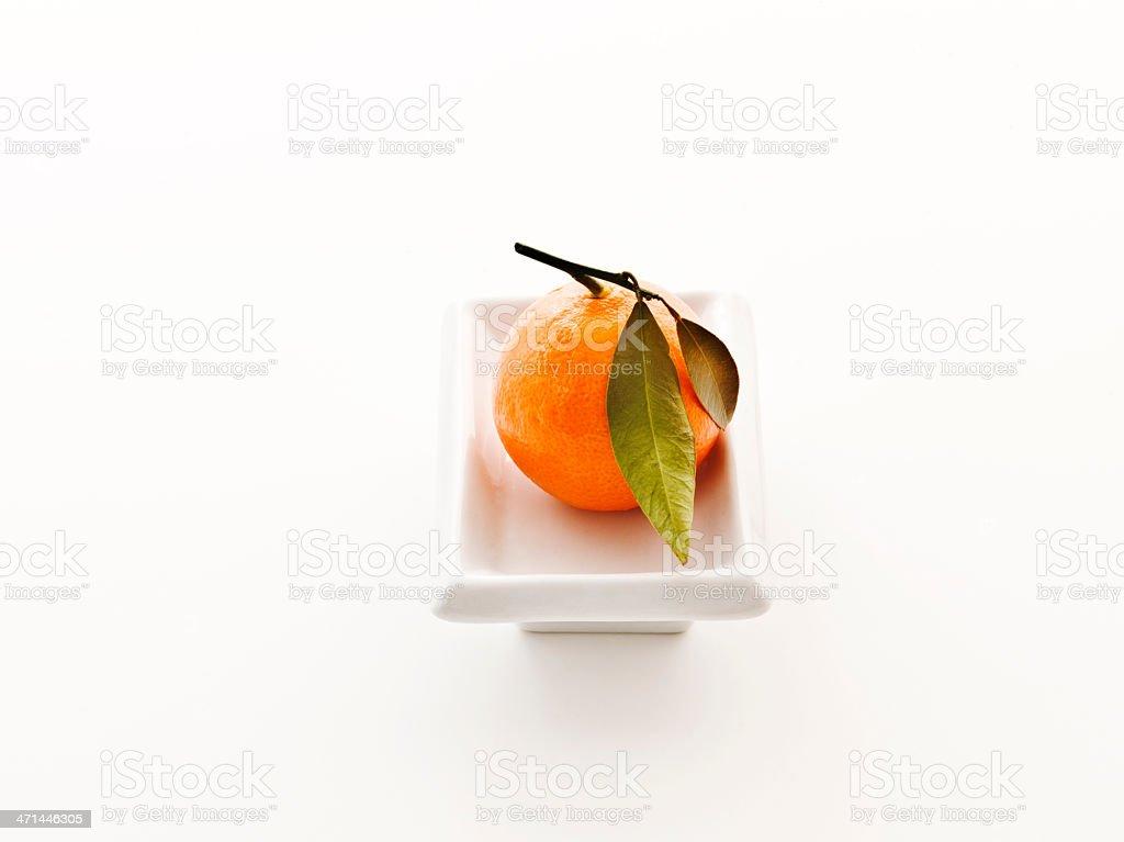mandarin on white plate stock photo