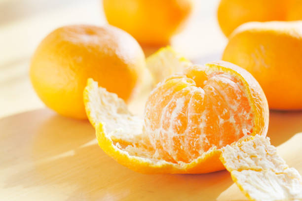 Mandarin orange on the table stock photo