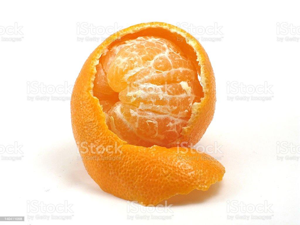 Mandarin orange peeking out of peel royalty-free stock photo