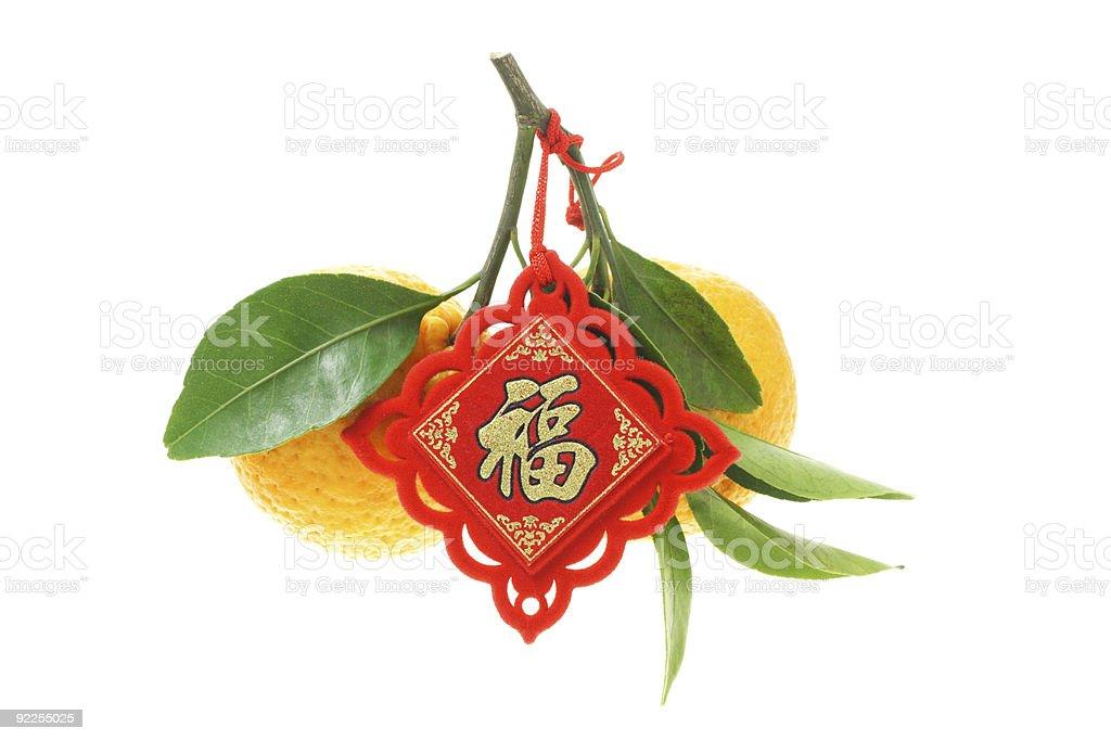 Mandarin oranges with trinket royalty-free stock photo