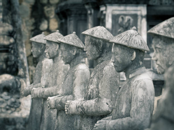 mandarin statues in Khai Dinh tomb in Hue Vietnam many stone soldiers mandarin statues in royal Khai Dinh tomb in Hue Vietnam khai dinh tomb stock pictures, royalty-free photos & images