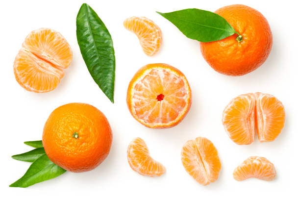 Mandarines Isolated on White Background Mandarines, tangerine, clementine with leaves isolated on white background. Top view orange fruit stock pictures, royalty-free photos & images