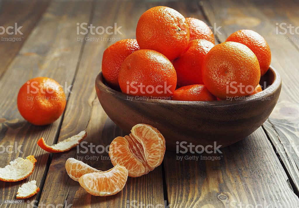 Mandarins in the wooden bowl stock photo
