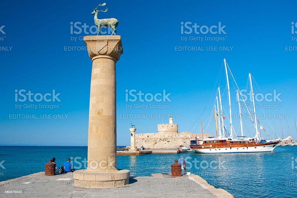 Mandraki harbor with famous bronze deer on Rhodes island, Greece. stock photo