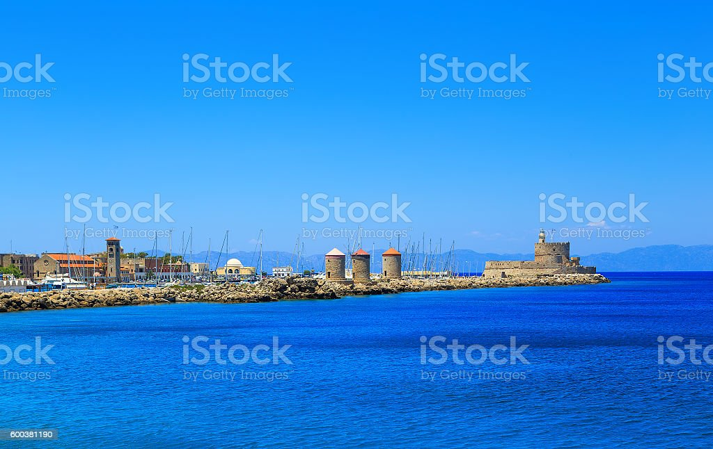 Mandraki harbour and fortress Agios Nicolaos in Rhodes town, Greece stock photo