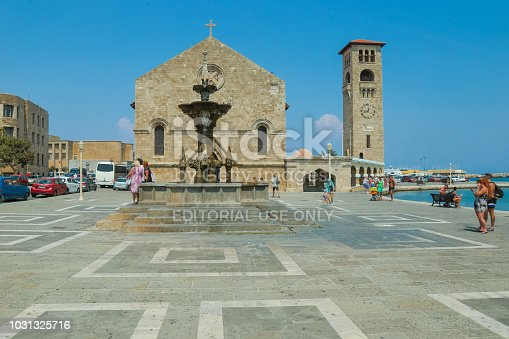 istock Mandraki harbour, Rhodes, Greece - The Church Evangelismos (Annunciation) 1031325716