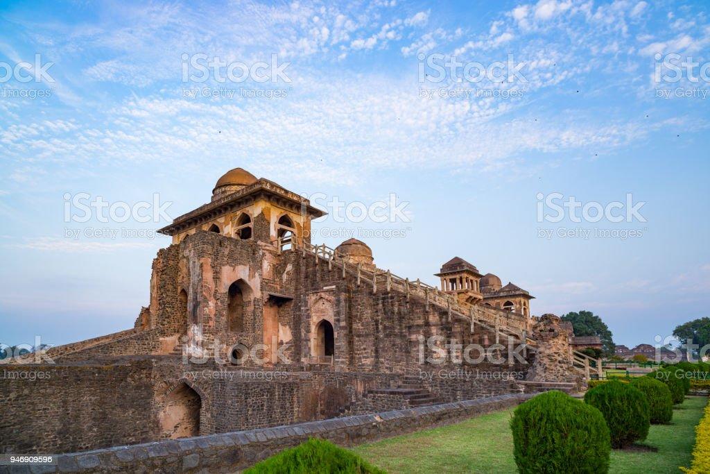 Mandu India, afghan ruins of islam kingdom, mosque monument and muslim tomb. View through door, Hindola Mahal. stock photo
