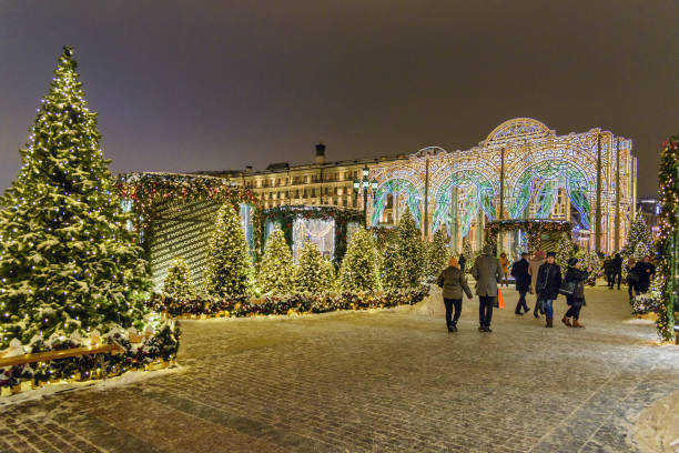 Manezhnaya square with Christmas and New years illuminations decoration at night in Moscow. Russia stock photo