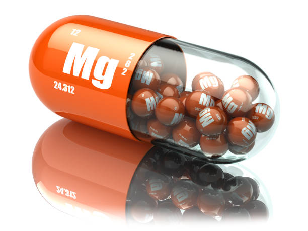 manganese magnesium mg element pill. dietary supplements. vitamin capsules. - magnesium stock photos and pictures