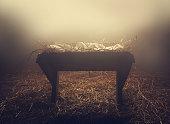 istock Manger at night under fog 585074222