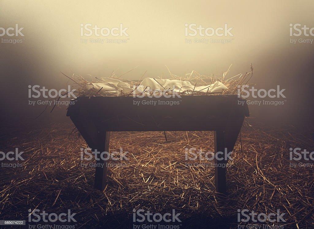 Manger at night under fog - Photo