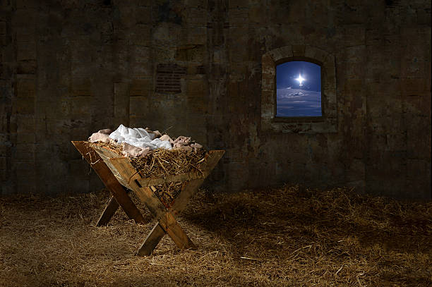 Manger in Old Barn with window Manger in barn with window showing Christmas star trough stock pictures, royalty-free photos & images