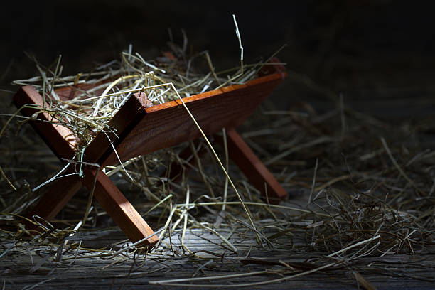 manger in the stable abstract christmas symbol - nativity scene stock pictures, royalty-free photos & images