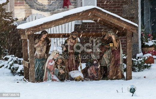 istock Manger scene on front lawn during a snow storm 898736876