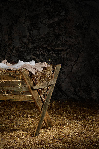 Manger with Clothes in Barn View of manger on straw covered floor in old barn trough stock pictures, royalty-free photos & images