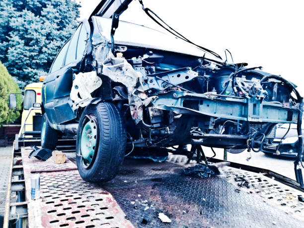 Mangled car involved in a road accident on a motorway stock photo