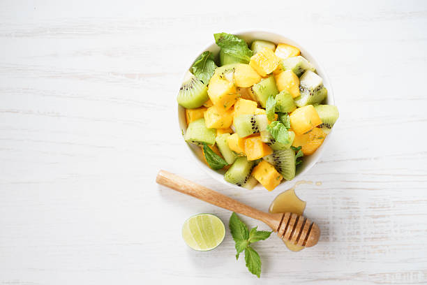 mango and kiwi fruit salad stock photo
