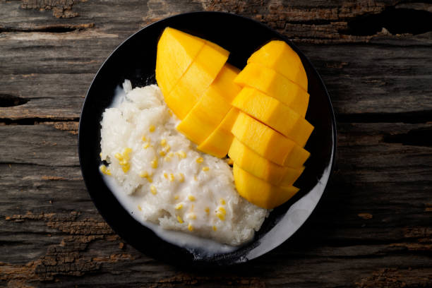 mango and sticky rice - sticky stock pictures, royalty-free photos & images
