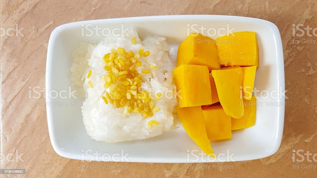 Mango and sticky rice with coconut milk stock photo