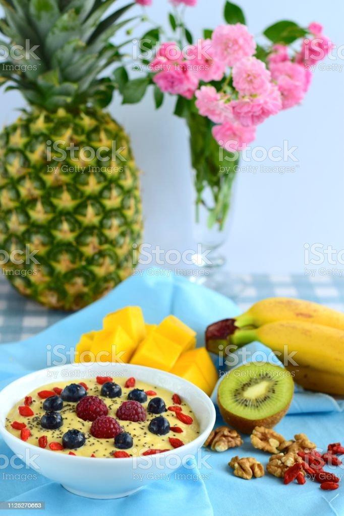 Mango Banana Kiwi Smoothie Bowl Topped With Walnut Goji Berry