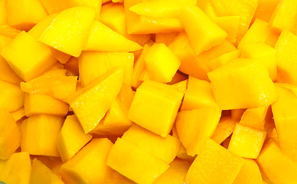 Mango diced on the skin Mango diced on the skin closeup square composition mango stock pictures, royalty-free photos & images