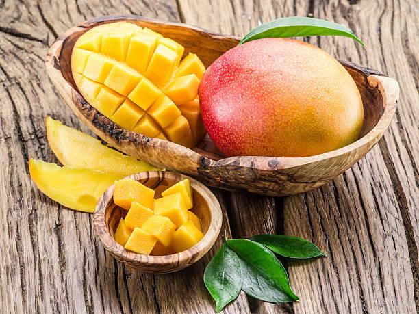 Mango fruit and mango cubes. stock photo