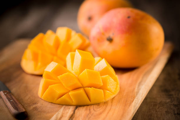 Mango fruit and mango slices Mango fruit and mango slices mango stock pictures, royalty-free photos & images