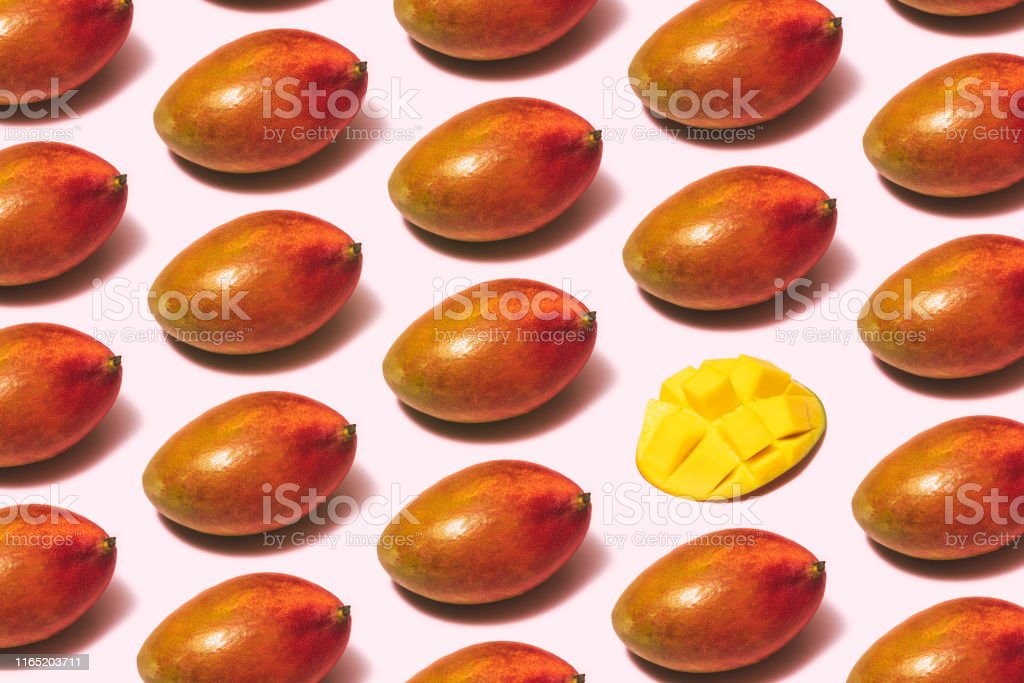 Mango fruit repetitive flat lay on pink background Mango fruit repetitive flat lay on pink background Antioxidant Stock Photo