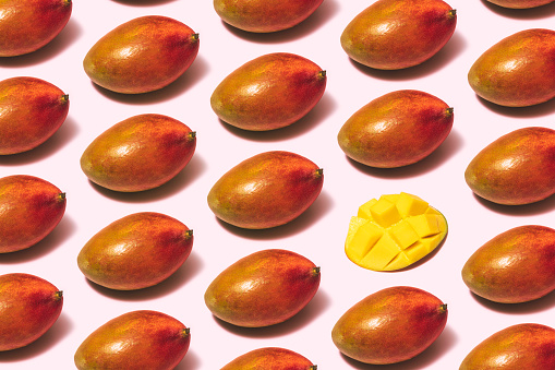Mango Fruit Repetitive Flat Lay On Pink Background Stock Photo - Download Image Now