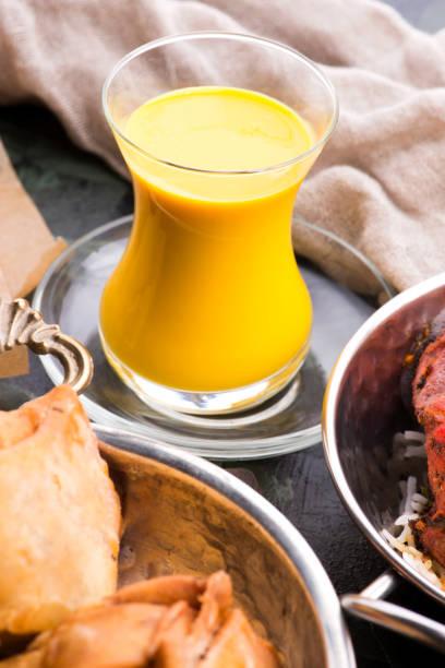 Mango Lassi, yogurt or smoothie. Healthy probiotic Indian popular summer drink stock photo