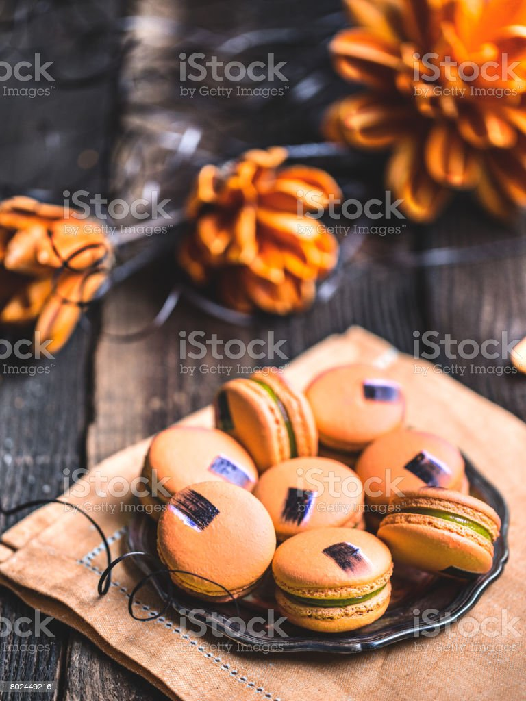 Mango macarons on a rustic wooden table. stock photo