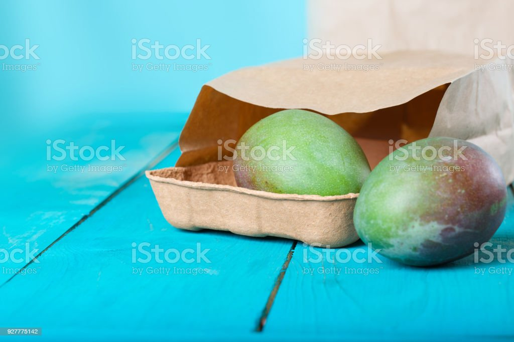 Mango on a cyan wooden surface. stock photo