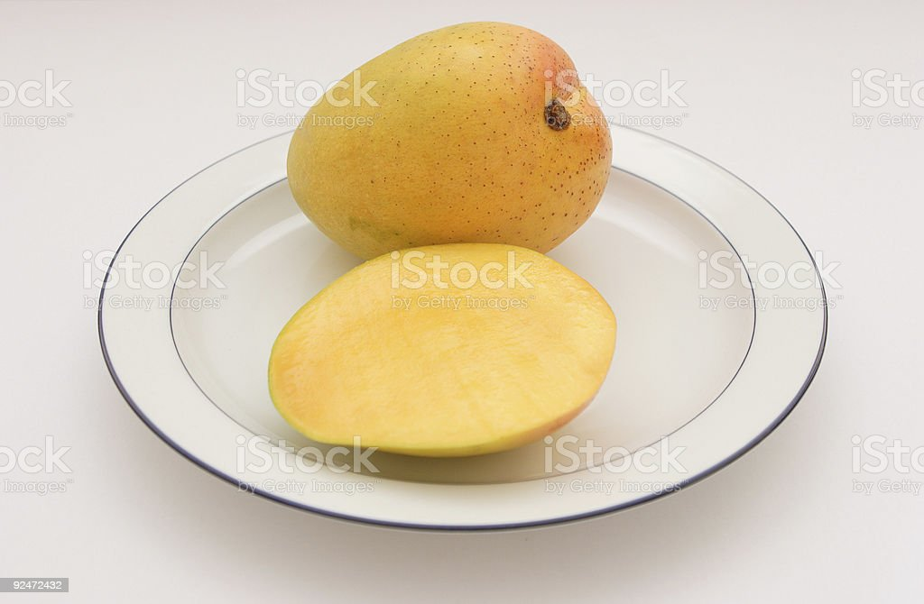 Mango on a Plate - Magnifera Indica royalty-free stock photo