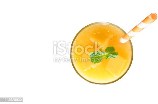Mango smoothies yellow fruit juice milkshake blend beverage healthy high protein the taste yummy In glass drink episode for weight loss isolated white background from the top view.