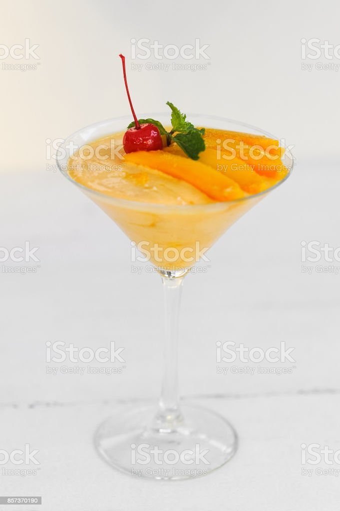 Mango sorbet in a glass stock photo