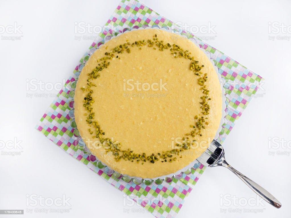 Mango sour cream cake serving stock photo