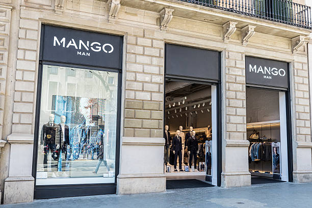 Mango store, Barcelona Barcelona, Spain - March 27, 2015: Mango shop located on Passeig de Gracia, one of the most expensive streets in Europe. gracia baur stock pictures, royalty-free photos & images