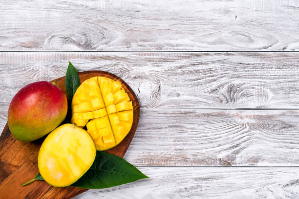 Mango. Tropical Fruits. On a wooden background. Top view. Copy space. stock photo